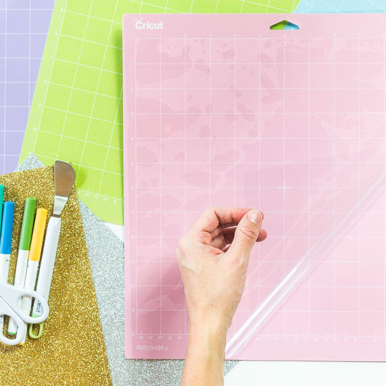 Pink Cricut Mat with cover being lifted up