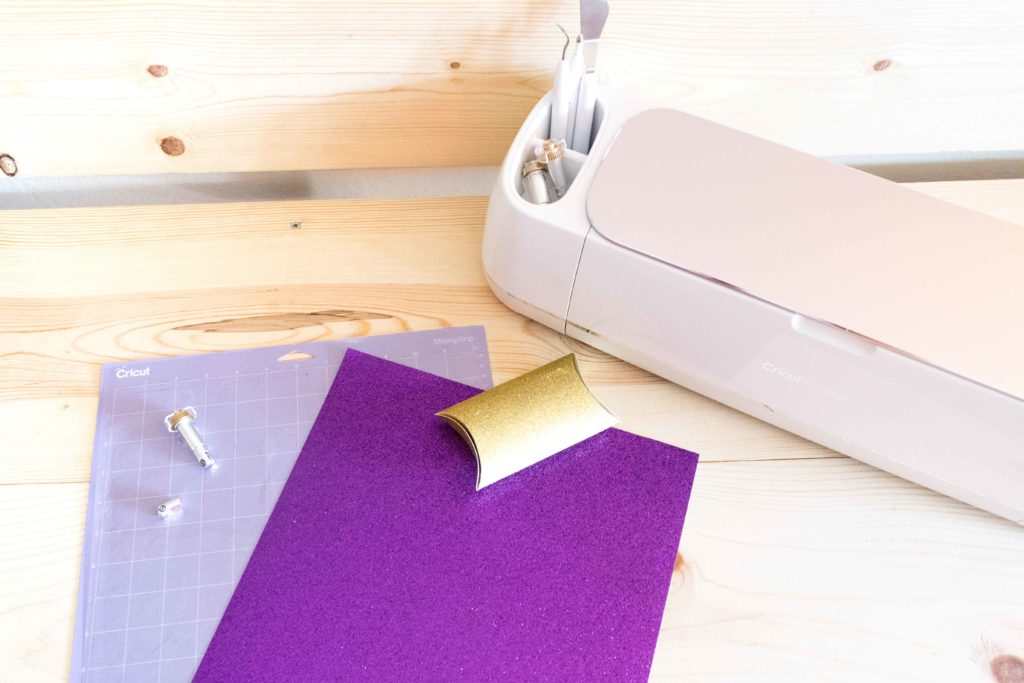 Cricut Maker and some materials to make a purple pillow box using the scoring wheel
