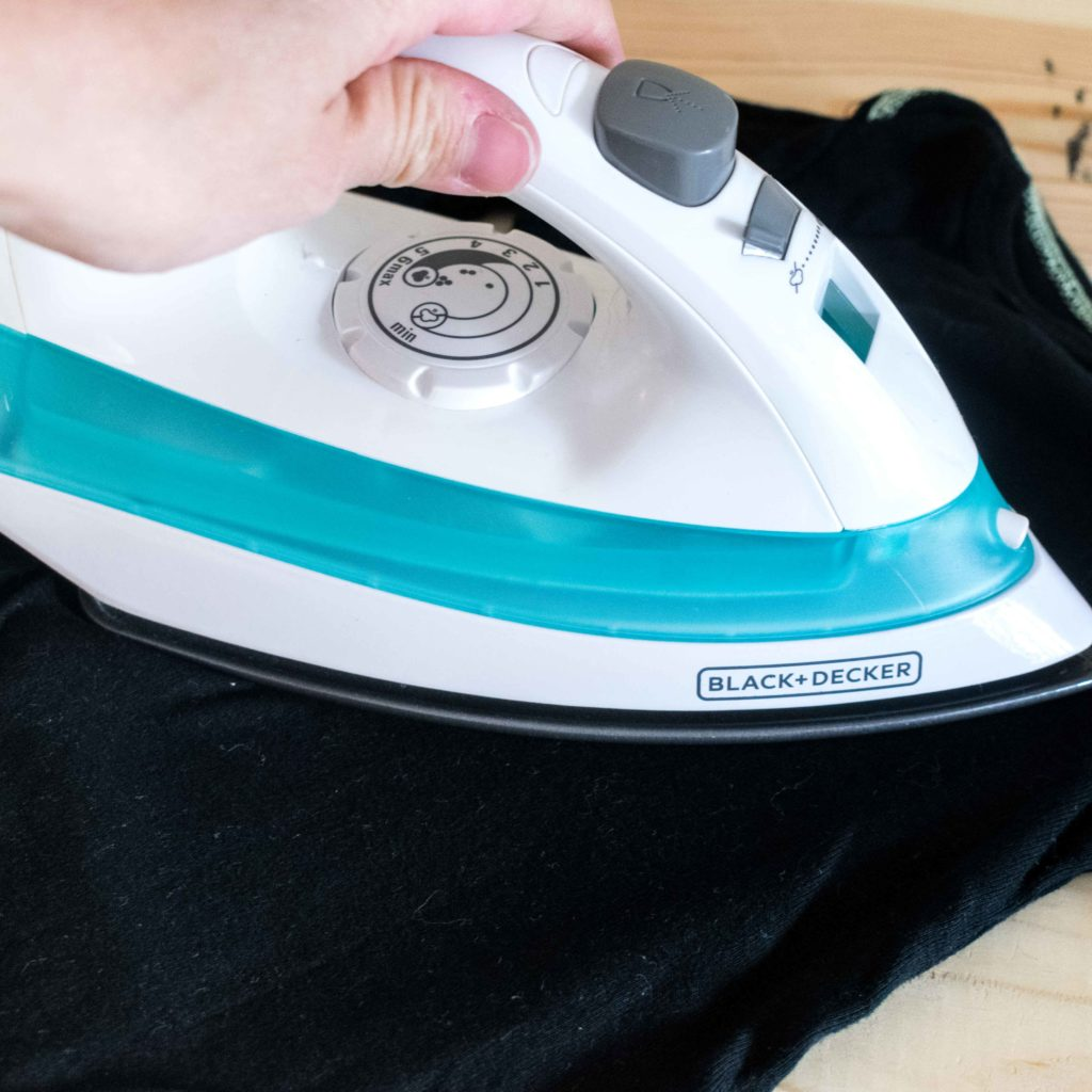 Pressing onesie with Iron t get rid of wrinkles