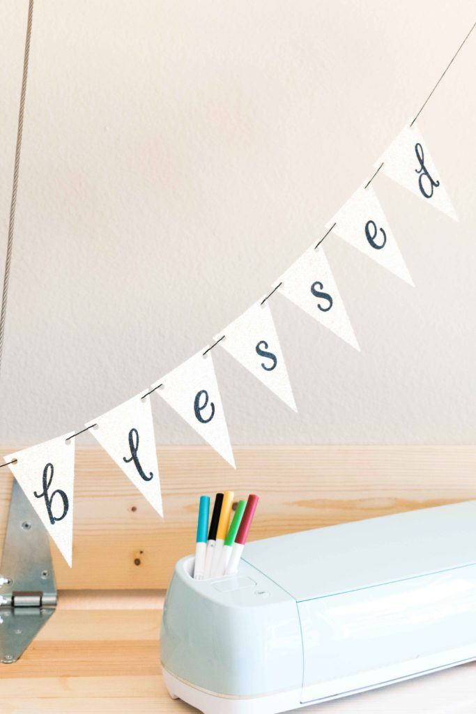 Displaying a triangular banner made with Cricut - The banner says blessed