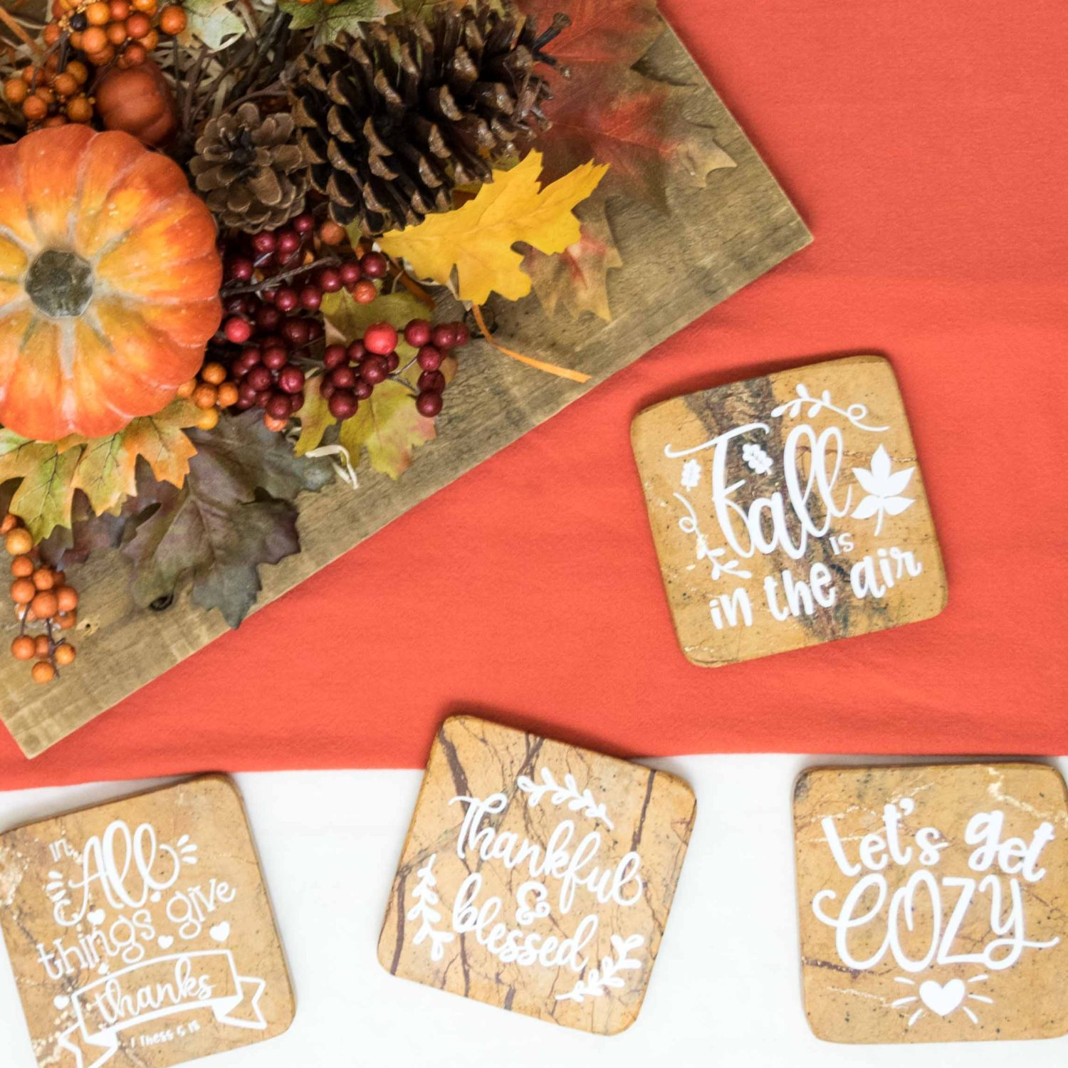 Coasters decorated with white vinyl for fall