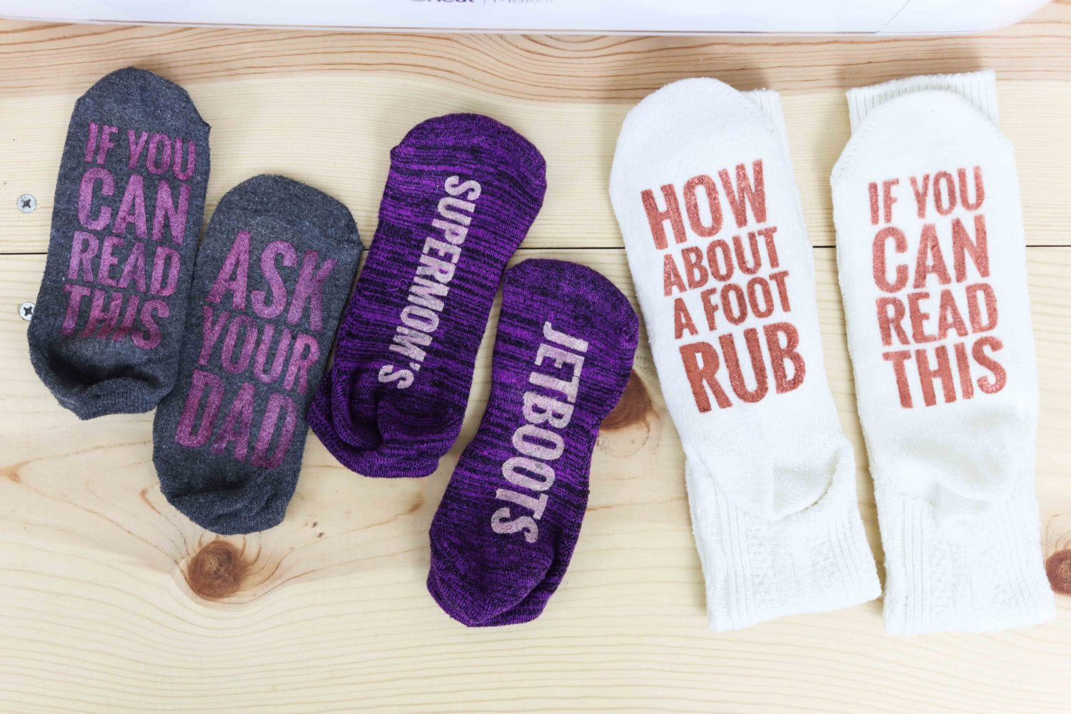 different types of socks made with metallic fabric paint made with freezer paper and cricut