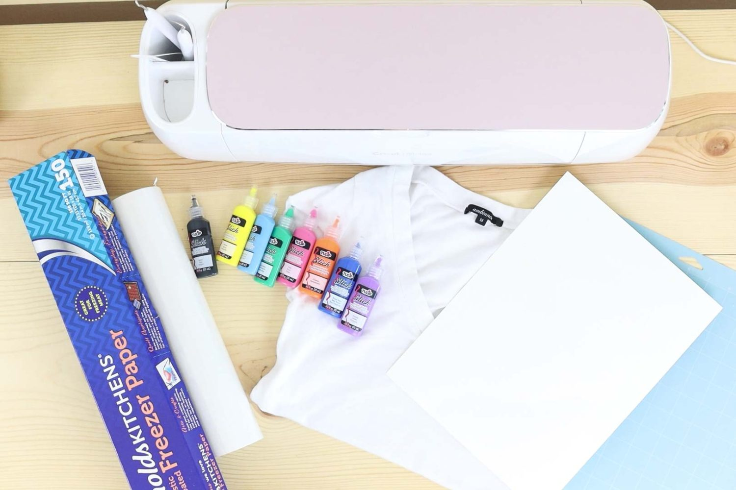 Materials needed to make a t-shirt with the freezer paper method