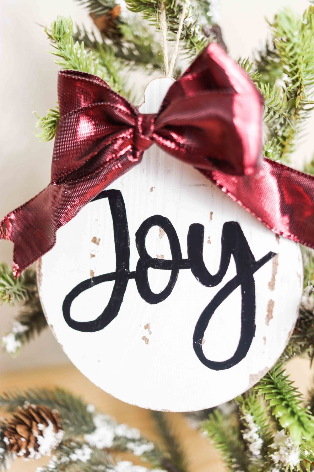 Beautiful wooden Christmas Ornament hanging on a Christmas Tress