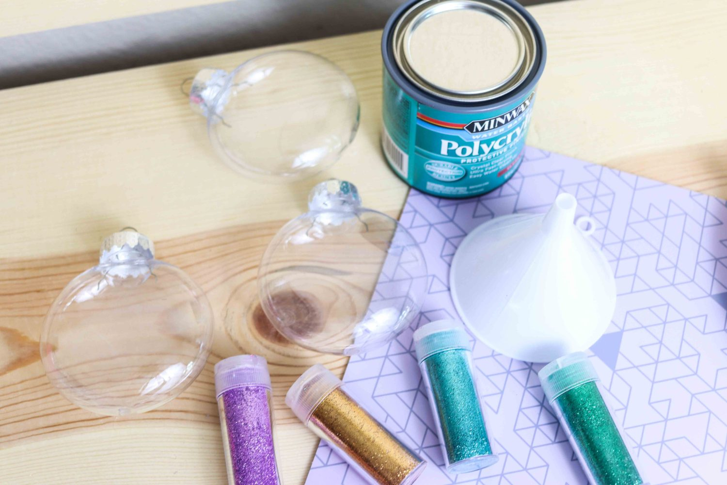 Materials needed to make glitter ornaments