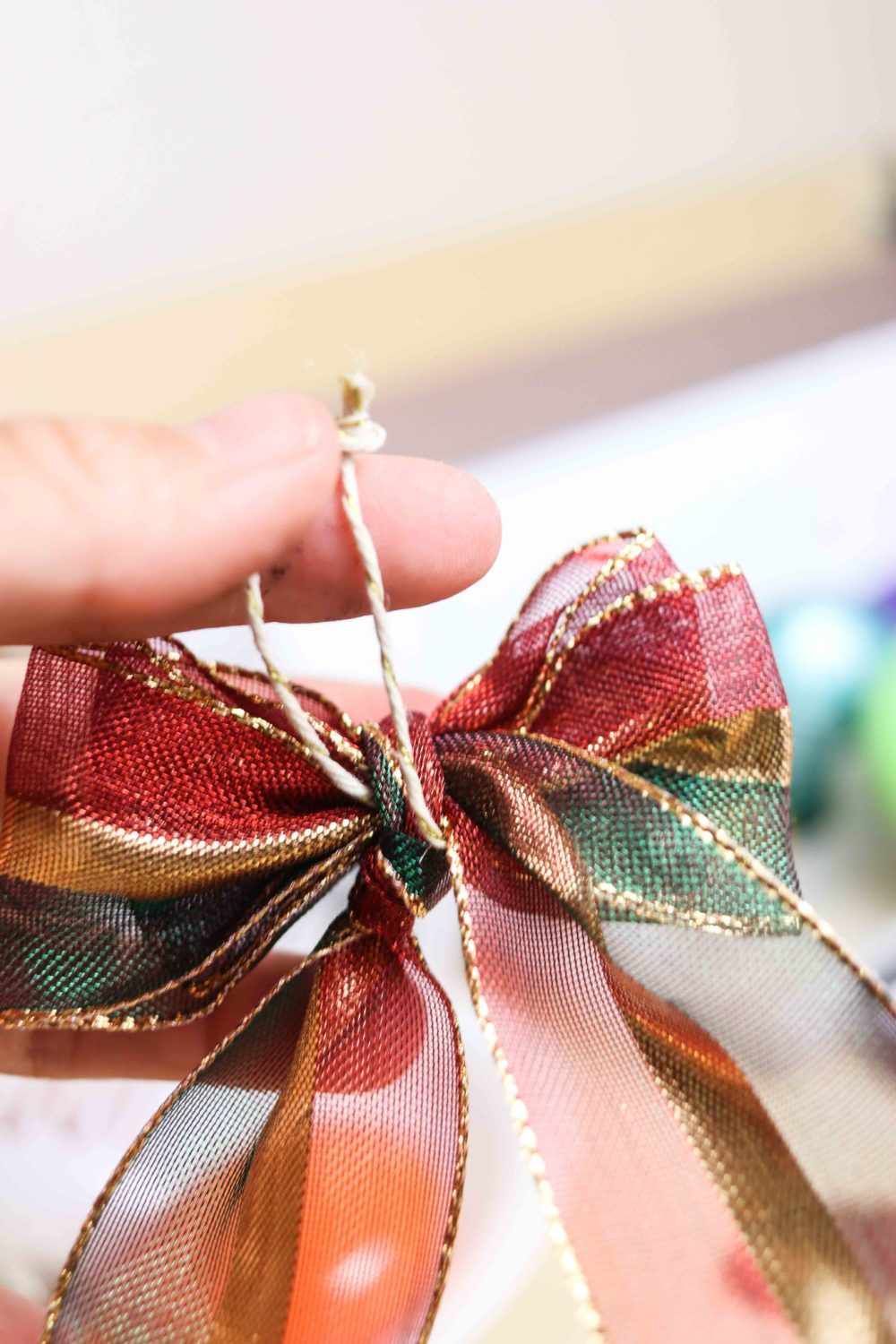 cord attach to decorative bow