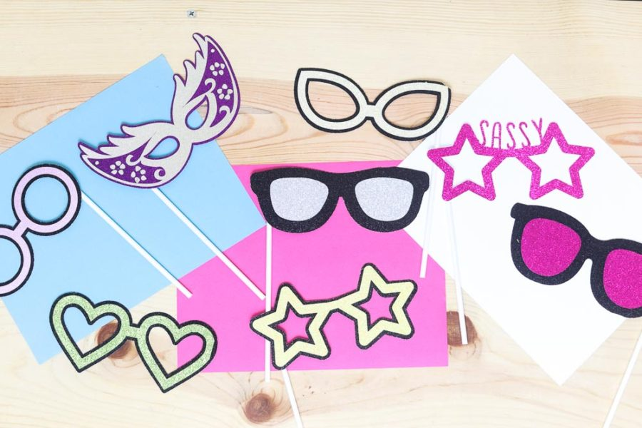 Asssorted colors and shapes of photo prop glasses made with a Cricut machine