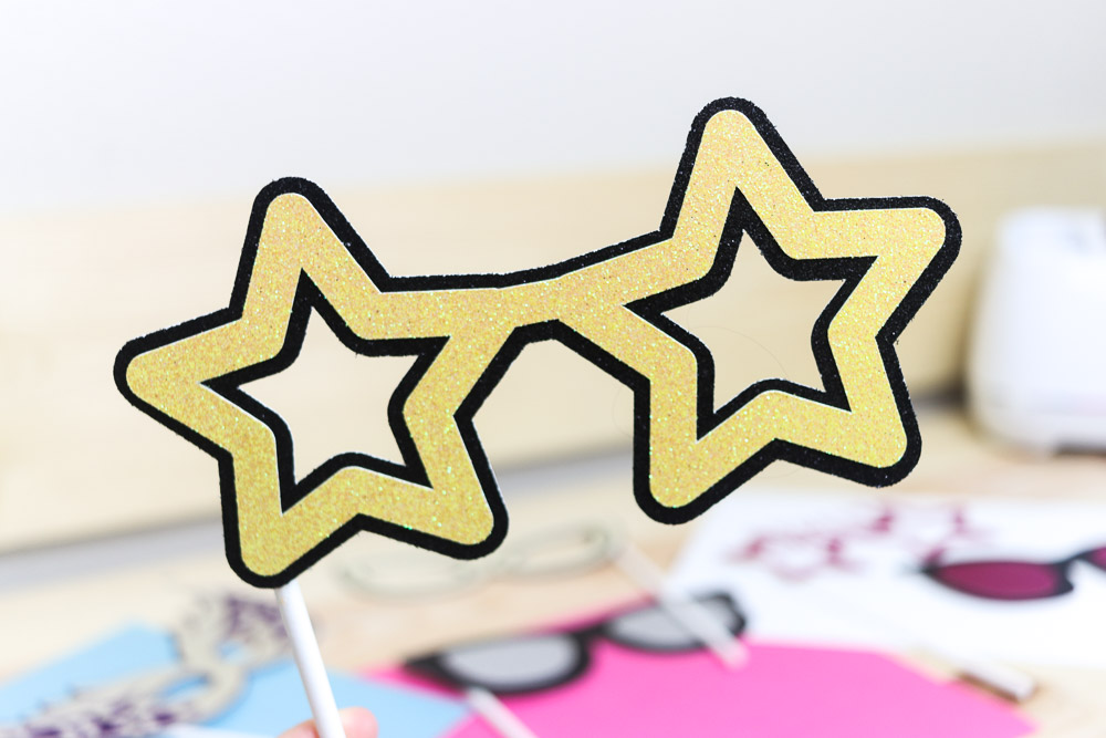 star shaped glasses made with glitter cardstock and Cricut