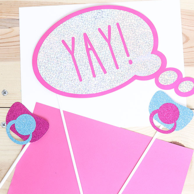 photo props for baby shower or gender reveal made with the Cricut machine